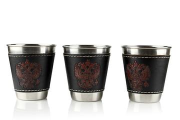 Three metal cups.