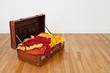 Leather suitcase full of orange and yellow clothing