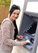 Beautiful woman using ATM
