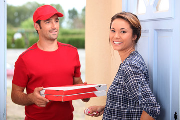 young man delivering pizza