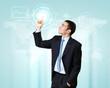 Businessman against technology background