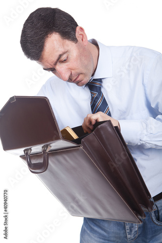 man holding a briefcase and putting documents inside