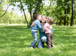 Portrait of mother and children in the park