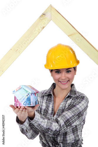 Builder with a house made of money