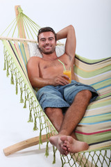 man lying in a hammock
