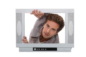 Concept shot of a young man trying to break into television