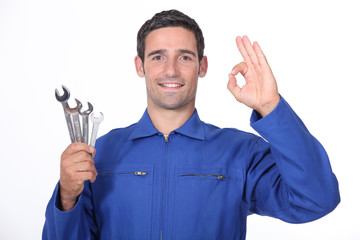 Mechanic making OK gesture