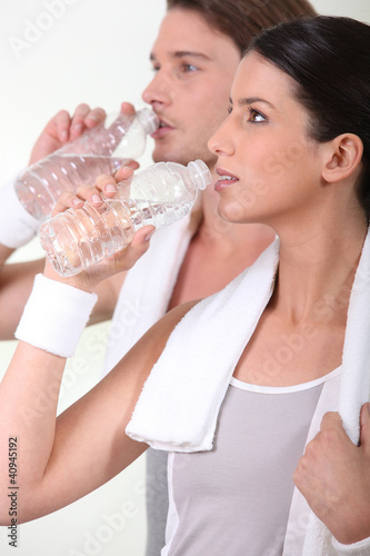 Sporty people drinking water