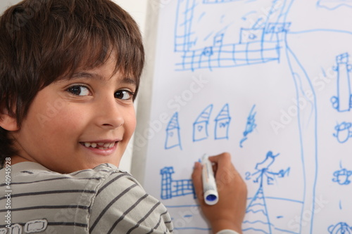 Boy drawing on blackboard
