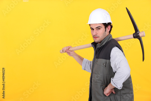 Confident worker with pick-axe