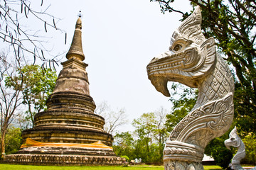 old pagoda and white naga head in thai temple