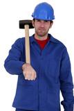 craftsman holding a hammer