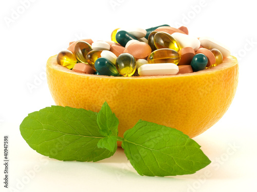 Concept shot with vitamin pills in a grapefruit
