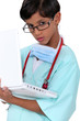 Boy dressed as surgeon