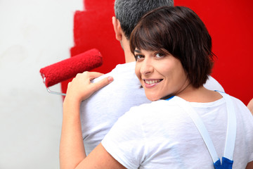 Couple painting in red