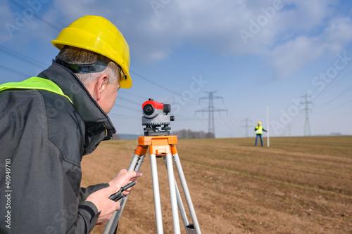 Leinwanddruck Bild Geodesist measure land speak transmitter