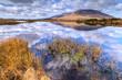 Connemara scenery of mountains reflected in lake, Ireland