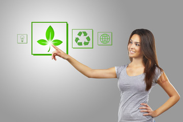 Young businesswoman pointing  recycle symbol, isolated