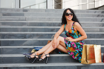 Young female shopper on the steps