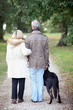 Senior people having a walk with dog
