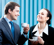 Businesspeople with coffee at office