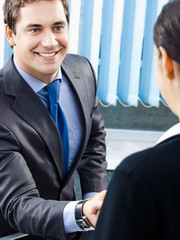 Businesspeople or businessman and client