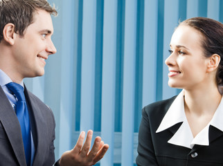 Two business people, or businessman and client