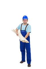 Construction worker carrying wooden plancks