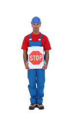 Man holding stop sign