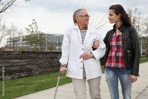 Woman strolling with an elderly lady