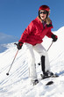 Woman On Ski Holiday In Mountains