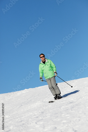 Man On Ski Holiday In Mountains