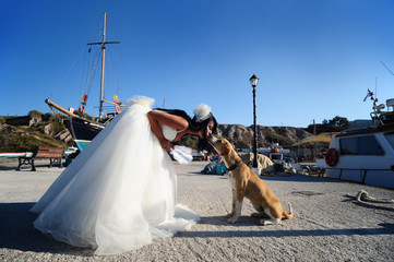 A bride in a Santorini port