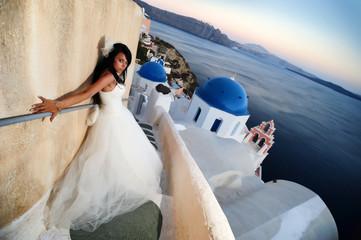Bride in Santorini at sunset