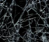 Broken glass over black background