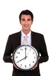 Happy businessman holding large clock
