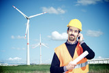 Engineer in Wind Turbine Power Generator Station talk at phone