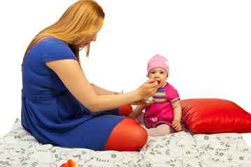 Mother giving baby to eat puree