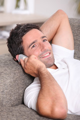 Closeup of a man talking on the telephone at home