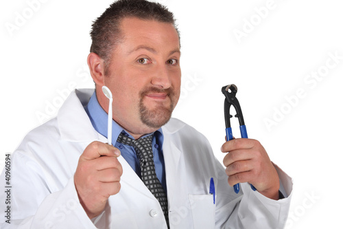 Dentist with a pair of pliers