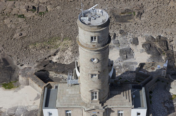 Aerial view of lighthouse with radar antenna