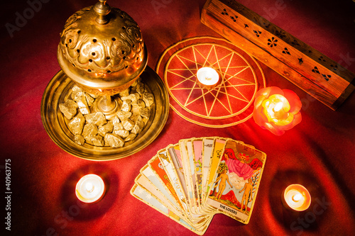 Tarot cards illuminated by candlelight.
