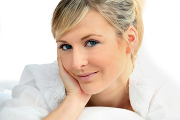 Blond woman in dressing gown