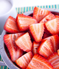 Sliced strawberries in a wringer