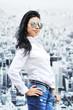 Portrait of beautiful brunette girl in sunglasses
