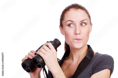 pretty woman holding binoculars