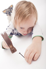 boy with hammer and nail,partly isolated
