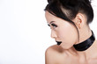 Profile of asian female with creative black makeup
