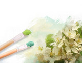 Artist brushes with a half finshed painted floral canvas
