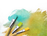 Artist brushes with a half finished painted canvas - Fine Art prints